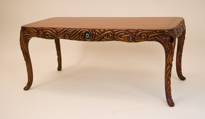 Carved and inlaid mahogany table